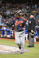 19 March 2009: #23 Norichika Aoki of Japan celebrates as he scores during the 2009 World Baseball Classic Pool 1 game 6 at Petco Park in San Diego, California, USA. Japan wins 6-2 over Korea.