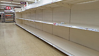 Empty shelves caused by panic buying, Sainsbury's super market store in Swansea, Wales, UK.