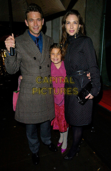 DOUGRAY SCOTT, daughter & CLAIRE FORLANI.Attend The Emeralds & Ivy Ball, Old Billingsgate Market, London, England, November 30th 2007..full length grey coat umbrella raining clare couple.CAP/CAN.©Can Nguyen/Capital Pictures