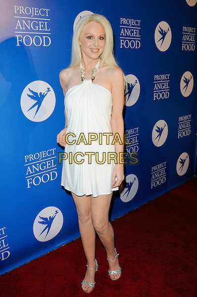 DONNA SPANGLER .Arriving at the Divine Design Gala Benefit for Project Angel Food at the Beverly Hilton Hotel in Beverly Hills, California, USA, December 3rd 2009..full length white dress halterneck silver sandals .CAP/ROT.©Lee Roth/Capital Pictures