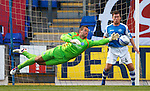 Alan Mannus tips the ball away as Paddy Cregg gasps in amazement