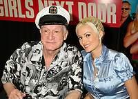"27 September 2017 - Hugh Marston Hefner aka ""Hef"" was an American magazine publisher, editor, businessman, and international playboy best known as the editor-in-chief and publisher of Playboy magazine, which he founded in 1953. Hefner was the founder and chief creative officer of Playboy Enterprises, the publishing group that operates the magazine. Hefner was also a political activist and philanthropist. File Photo: 3 August 2006 - West Hollywood, California. Hugh Hefner and Holly Madison. ""The Girls Next Door"" DVD and Magazine Signing at Tower Records. Photo Credit: Byron Purvis/AdMedia"