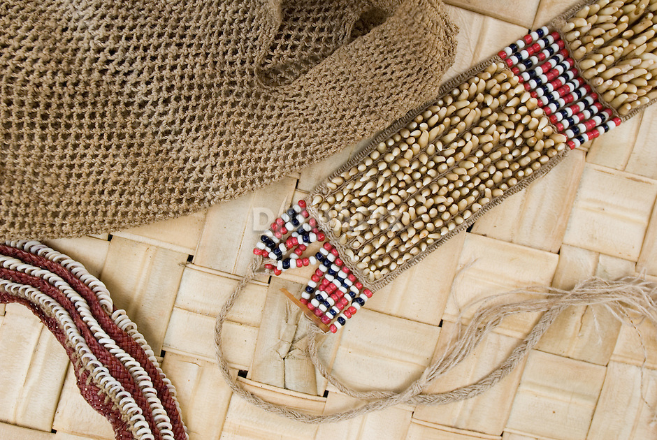 "Treasures from Lucy Bako's Magoha (""custom basket"")--relics that signify land ownership. This arm band is woven out of hundreds of cuscus teeth. A cuscus is an arboreal, marsupial, possum-like creature.)"