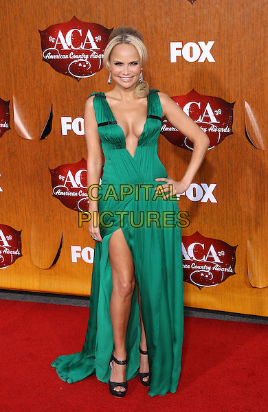 Kristin Chenoweth.2011 American Country Awards at the MGM Grand Casino Resort, Las Vegas, Nevada, USA..December 5th, 2011.full length green dress low cut plunging neckline cleavage slit split black shoes open toe ankle strap hand on hip.CAP/ADM/MJT.© MJT/AdMedia/Capital Pictures.