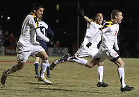 Billy Cortes #7 and Alex Lee #18 of the University of Maryland follow Taylor Kemp #2 after he had scored the winning goal during an NCAA 3rd. round match against Penn State at Ludwig Field, University of Maryland, College Park, Maryland on November 28 2010.Maryland won 1-0.