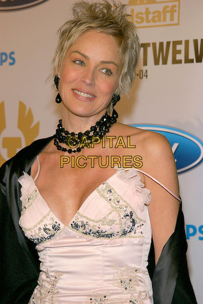 "SHARON STONE.Los Angeles Premiere of ""Ocean's Twelve"" held at the Grauman's Chinese Theatre.8 December 2004.portrait headshot black choker necklace.www.capitalpictures.com.sales@capitalpictures.com.© Capital Pictures."