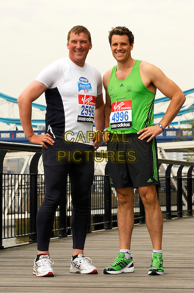 SIR MATTHEW PINSENT & JAMES CRACKNELL.Virgin London Marathon photocall, London, England..April 15th, 2011.exercise full length spandex black grey t-shirt gray shorts green tank top white handS on hips trainers sneakers .CAP/CJ.©Chris Joseph/Capital Pictures.
