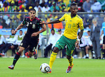 11 June 2010, South African defender Teko Modise is chased by Mexican Carlos Salcido in the opening game of the 2010 Fifa World Cup between South Africa and Mexico at the Soccer City stadium in Johannesburg. The game ended in a one all draw. Picture: Shayne Robinson