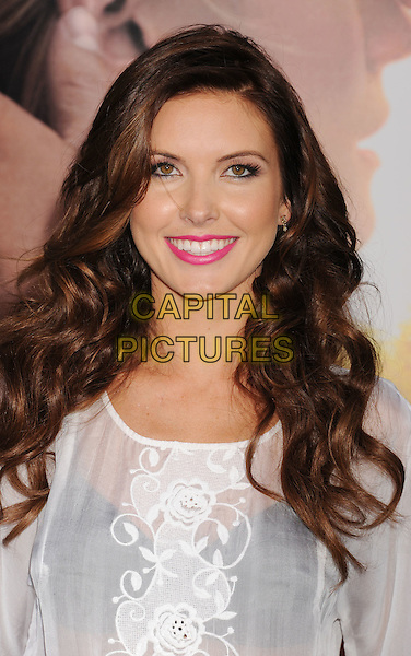 "Audrina Patridge.""The Lucky One"" Los Angeles Premiere held at Grauman's Chinese Theatre, Hollywood, California, USA..April 16th, 2012.headshot portrait white sheer top see through thru black bra pink lipstick .CAP/ROT/TM.©Tony Michaels/Roth Stock/Capital Pictures"