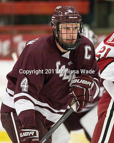 Corbin McPherson (Colgate - 4) - The Harvard University Crimson defeated the visiting Colgate University Raiders 4-2 on Saturday, November 12, 2011, at Bright Hockey Center in Cambridge, Massachusetts.