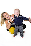 Fitness trainer Shana Verstegen is pictured with her fourteen-month-old son, Greyson, in a studio portrait in Madison, Wis., on Aug. 21, 2016. (Photo by Jeff Miller, www.jeffmillerphotography.com)
