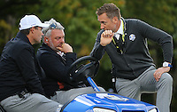 Ian Poulter, Team Europe Ryder Cup Vice-Captain,  has a pep-talk with Darren Clarke, Team Europe Ryder Cup Captain,  and Padraig Harrington, Team Europe Ryder Cup Vice-Captain,  during Thursday's Practice Round ahead of The 2016 Ryder Cup, at Hazeltine National Golf Club, Minnesota, USA.  29/09/2016. Picture: David Lloyd | Golffile.