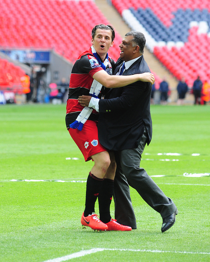 Queens Park Rangers' Joey Barton, left, celebrate promotion to the Premier League with Queens Park Rangers' chairman Tony Fernandes<br /> <br /> Photographer Chris Vaughan/CameraSport<br /> <br /> Football - The Football League Sky Bet Championship Play-Off Final - Derby County v Queens Park Rangers - Saturday 24th May 2014 - Wembley Stadium - London<br /> <br /> &copy; CameraSport - 43 Linden Ave. Countesthorpe. Leicester. England. LE8 5PG - Tel: +44 (0) 116 277 4147 - admin@camerasport.com - www.camerasport.com