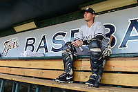 Tampa Yankees catcher Trent Garrison (11) sits in the dugout before a game against the Lakeland Flying Tigers on April 5, 2014 at Joker Marchant Stadium in Lakeland, Florida.  Lakeland defeated Tampa 3-0.  (Mike Janes/Four Seam Images)