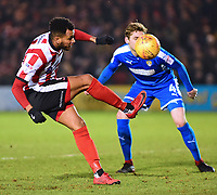 Lincoln City's Matt Green under pressure from Notts County's Elliott Hewitt<br /> <br /> Photographer Andrew Vaughan/CameraSport<br /> <br /> The EFL Sky Bet League Two - Lincoln City v Notts County - Saturday 13th January 2018 - Sincil Bank - Lincoln<br /> <br /> World Copyright &copy; 2018 CameraSport. All rights reserved. 43 Linden Ave. Countesthorpe. Leicester. England. LE8 5PG - Tel: +44 (0) 116 277 4147 - admin@camerasport.com - www.camerasport.com