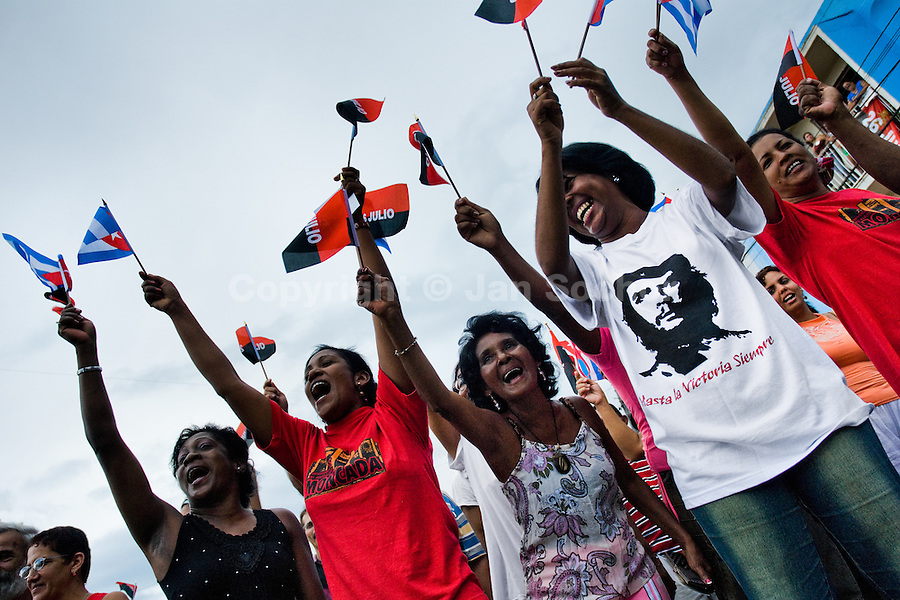Cuban women wave the national flags and excitedly express support for the regime of Fidel Castro and his brother Raul Castro during the celebration of the Cuban Revolution anniversary in Santiago de Cuba, Cuba, 26 July 2008. The Cuban revolution began when the poorly armed Cuban rebels, led by Fidel Castro, attacked the Moncada Barracks in Santiago de Cuba on 26 July 1953. The attack was easily defeated and most of the rebels were captured and later executed by the Batista regime. Although Fidel Castro had been sentenced to 15 years of prison, after less than two years he was released, he went to Mexico and in 1956, back in Cuba again, his guerilla group started a new rebellion.