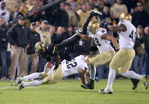 October 01, 2011:  Purdue wide receiver Gary Bush (#6) is upended by Notre Dame safety Harrison Smith (#22) during NCAA Football game action between the Notre Dame Fighting Irish and the Purdue Boilermakers at Ross-Ade Stadium in West Lafayette, Indiana.  Notre Dame defeated Purdue 38-10.