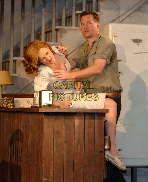 "CHARLOTTE EMMERSON & VAL KILMER.""The Postman Always Rings Twice"" production photocall.The Playhouse Theatre.London 31 May 2005..full length holding counter play costume stage touching.www.capitalpictures.com.sales@capitalpictures.com.©Capital Pictures"