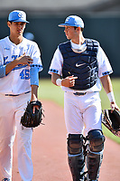 North Carolina Tar Heels starting pitcher Austin Bergner (45) and catcher Cody Roberts (11) before a game against the Pittsburgh Panthers at Boshamer Stadium on March 17, 2018 in Chapel Hill, North Carolina. The Tar Heels defeated the Panthers 4-0. (Tony Farlow/Four Seam Images)