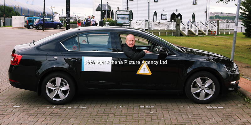 Pictured: Dr Peter O'Keefe with his Skoda Uber taxi in Cardiff Bay. Tuesday 05 September 2017<br /> Re: A heart surgeon who has accepted a cash settlement from the health board he accused of sacking him unfairly is now working as an Uber taxi driver.<br /> Peter O'Keefe, was working as a consultant cardiac surgeon at the University Hospital of Wales in Cardiff and was suspended for more than three years. Health workers accused him of bullying and harassing them before being dismissed.<br /> An employment tribunal case, which was due to begin yesterday, was called off after Cardiff & Vale University Health Board reached a settlement agreement with him.