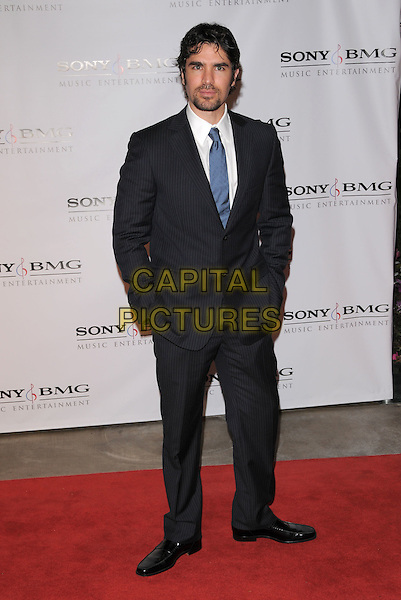 EDUARDO VERASTEGUI.The 2008 Sony BMG Post Grammy Party held at The Beverly Hills Hotel in Beverly Hills, California, USA..February 10th, 2008                                                                                            full length black suit hands in pockets .CAP/DVS.©Debbie VanStory/Capital Pictures.