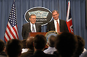 United States Secretary of Defense Donald H. Rumsfeld (left) and Britain's Secretary of State for Defence Geoffrey Hoon (right) listen to a reporter's question during a joint press conference in the Pentagon in Washington, DC on February 12, 2003.  Rumsfeld and Hoon met earlier to discuss the war on terror and the situation with Iraq.  <br /> Mandatory Credit: Robert D. Ward / DoD via CNP