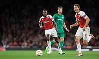 Danny Welbeck of Arsenal & Yuriy Kolomoyets of Vorskla Poltava during the UEFA Europa League match group between Arsenal and Vorskla Poltava at the Emirates Stadium, London, England on 20 September 2018. Photo by Andrew Aleksiejczuk / PRiME Media Images.