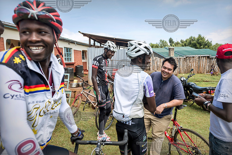 The Kenyan Riders, a Kenyan cycling team, discuss their training schedule with their Singaporean manager Nicholas Leong (The team is trained by Australian Simon Blake) while gathered at their training camp in Iten. The small town in the highlands, on the edge of the Great Rift Valley, at an altitude of 2400 metres, is a perfect location for high altitude training.