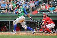 Right fielder Elier Hernandez (12) of the Lexington Legends bats in a game against the Greenville Drive on Sunday, April 27, 2014, at Fluor Field at the West End in Greenville, South Carolina. Hernandez is the No. 11 prospect of the Kansas City Royals, according to Baseball America. The Greenville catcher is Jake Romanski. Greenville won, 21-6. (Tom Priddy/Four Seam Images)