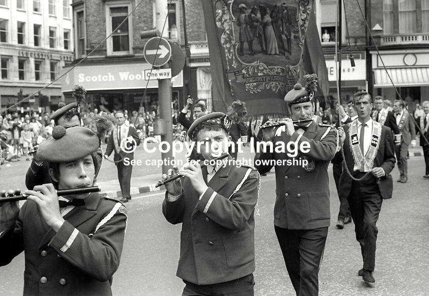 Twelfth, Belfast, N Ireland, 12th July 1969 - Flute band leads Orangemen through central Belfast on their way to The Field, Finaghy, South Belfast, N Ireland. 196907120189d<br /> <br /> Copyright Image from Victor Patterson, 54 Dorchester Park, Belfast, UK, BT9 6RJ<br /> <br /> t: +44 28 9066 1296<br /> m: +44 7802 353836<br /> vm +44 20 8816 7153<br /> <br /> e1: victorpatterson@me.com<br /> e2: victorpatterson@gmail.com<br /> <br /> www.victorpatterson.com<br /> <br /> IMPORTANT: Please see my Terms and Conditions of Use at www.victorpatterson.com