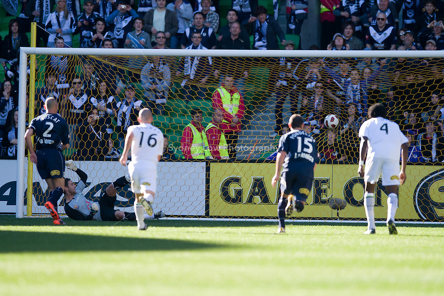 MELBOURNE, AUSTRALIA - AUGUST 22, 2010: Kevin Muscat from the Victory scores a penalty in Round 3 of the 2010 A-League between the Melbourne Victory and North Queensland Fury at AAMI Park on August 22, 2010 in Melbourne, Australia. (Photo by Sydney Low / Asterisk Images)