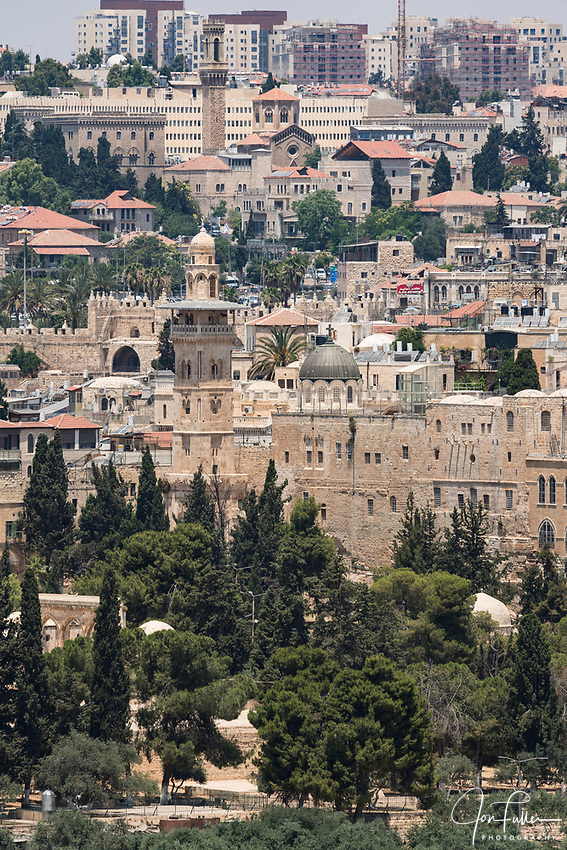 The al-Ghawanima Minaret on the edge of the Temple Mount and Muslim Quarter in the Old City of Jerusalem.  The Old City of Jerusalem and its Walls is a UNESCO World Heritage Site.  The trees on the al-Haram ash-Sharif or Temple Mount are in the foreground.
