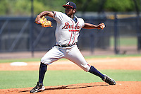 GCL Braves pitcher Oriel L. Caicedo (11) delivers a pitch during the first game of a doubleheader against the GCL Yankees 1 on July 1, 2014 at the Yankees Minor League Complex in Tampa, Florida.  GCL Yankees 1 defeated the GCL Braves 7-1.  (Mike Janes/Four Seam Images)
