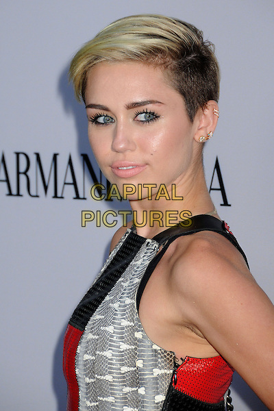 Miley Cyrus<br /> &quot;Paranoia&quot; Los Angeles Premiere held at the Directors Guild of America, West Hollywood, California, USA, 8th August 2013.<br /> portrait headshot side beauty black leather sleeveless perforated silver gold earrings makeup grey gray snakeskin <br /> CAP/ADM/BP<br /> &copy;Byron Purvis/AdMedia/Capital Pictures