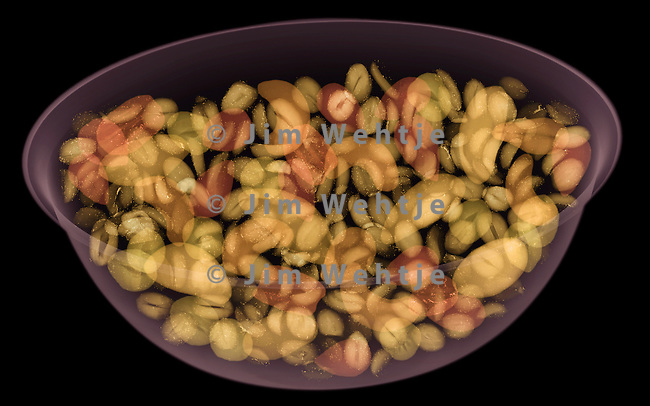 X-ray image of shelled nuts in a bowl (color on black) by Jim Wehtje, specialist in x-ray art and design images.