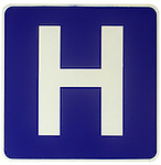 sign with white capital H against blue background, universal icon for hospital