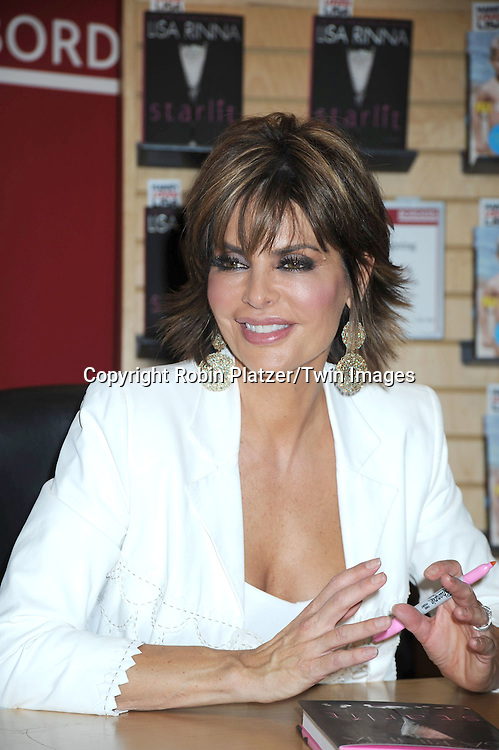 "Harry Hamlin and wife Lisa Rinna signing their new books ""Full Frontal Nudity"" by Harry and ""Starlit"" by Lisa Rinna on Oct 5, 2010 at Borders Books at Time Warner Center in New York City. They have a new TV Land Show starting Oct 6, 2010 called ""Harry Loves Lisa"".Robin Platzer/ Twin Images"