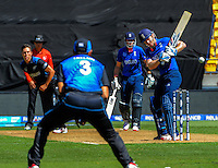 Eoin Morgan lets a Trent Boult delivery go during the ICC Cricket World Cup one day pool match between the New Zealand Black Caps and England at Wellington Regional Stadium, Wellington, New Zealand on Friday, 20 February 2015. Photo: Dave Lintott / lintottphoto.co.nz