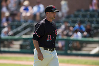 Visalia Rawhide pitching coach Jeff Bajenaru (11) walks to the dugout after a visit to the mound during a California League game against the Stockton Ports at Visalia Recreation Ballpark on May 9, 2018 in Visalia, California. Stockton defeated Visalia 4-2. (Zachary Lucy/Four Seam Images)