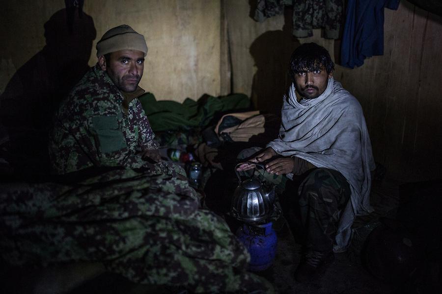 Two soldiers just woke up and prepare tea in their room of the checkpoint, Kunar, Afghanistan, 16th November 2017. <br /> <br /> Deux soldats se  réveillent et préparent du thé dans leur chambre du poste avancé, Kunar, Afghanistan,Kunar, Afghanistan, 16 novembre 2017.