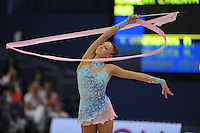 September 11, 2009; Mie, Japan;  Evgeniya Kanaeva of Russia expresses with ribbon at 2009 World Championships Mie. Evgeniya became world champion at Mie and was the 2008 gold individual medalist in rhythmic gymnastics at the Beijing Olympics. Photo by Tom Theobald .