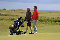 Gary O'Flaherty (Cork) and his caddy Michael McCabe on the 1st during Round 3 of the East of Ireland Amateur Open Championship at Co. Louth Golf Club in Baltray on Sunday 4th June 2017.<br /> Photo: Golffile / Thos Caffrey.<br /> <br /> All photo usage must carry mandatory copyright credit     (&copy; Golffile | Thos Caffrey)