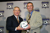 San Jose Earthquakes General Manager, Johny Moore, and new Head Coach Dominic Kinnear pose for a photo at a news conference to announce Kinnear's hiring.