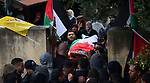 Mourners carry the body of Palestinian Elias Saleh Yassin, 22, who was shot dead by Israeli forces for allegedly attempting to carry out a stabbing attack near the Jit crossroads on October 15 and Israeli army kept his body withheld since that, during his funeral in the West Bank city of Salfit on December 29, 2018. Photo by Shadi Jarar'ah