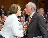 United States Senator Dianne Feinstein (Democrat of California), left, welcomes former US Senator Sam Nunn (Democrat of Georgia) prior to Christopher A. Wray testifying on his nomination to be Director of the Federal Bureau of Investigation (FBI) before the US Senate Committee on the Judiciary on Capitol Hill in Washington, DC on Wednesday, July 12, 2017.<br /> Credit: Ron Sachs / CNP<br /> (RESTRICTION: NO New York or New Jersey Newspapers or newspapers within a 75 mile radius of New York City)