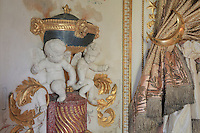 "Detail of putti which opened hands were designed to hold small torchs, and curtain tie backs, Turkish Boudoir, redesigned in 1777 for Marie Antoinette, by architect Richard Mique, Chateau de Fontainebleau, France. The decoration is the achievement of the brothers Rousseau, and the furniture dates to the period of the First Empire, with precious textile work done by Jacob-Desmalter for Empress Josephine. Including a small bedroom, mirrors, and curtains raised by pulleys, this exceptional ensemble has been restored in 2014 thanks to the support of INSEAD and the generosity of subscribers of sponsors belonging to the group ""Des Mécènes pour Fontainebleau"". Its opening to the public is schedule for Spring 2015. Picture by Manuel Cohen"