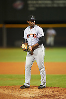 Jupiter Hammerheads relief pitcher Esmerling De La Rosa (16) gets ready to deliver a pitch during a game against the Lakeland Flying Tigers on March 14, 2016 at Henley Field in Lakeland, Florida.  Lakeland defeated Jupiter 5-0.  (Mike Janes/Four Seam Images)