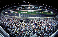 A huge crowd watches the Chevrolet Monte Carlo 400 NASCAR Winston Cup race at Richmond International Raceway in Richmond, VA on Saturday night, 9/9/00.  The race was won by Jeff Gordon.(Photo by Brian Cleary)
