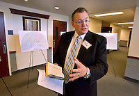 STAFF PHOTO BEN GOFF  @NWABenGoff -- 09/19/14 Simon Keogh, president of the Rogers Arkansas Stake of The Church of Jesus Christ of Later-day Saints, talks about the importance of genealogy while leading a tour of the church's new Bella Vista Chapel during an open house on Friday September 19, 2014.