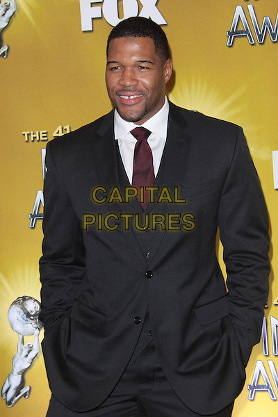 MICHAEL STRAHAN.41st Annual NAACP AWARDS Nomination Announcements and Press Conference  held at  The SLS Hotel, Beverly Hills, California, USA,.6th January 2010..half length suit beard stubble facial hair red tie grey gray hands in pockets .CAP/ADM/TC.©T.Conrad/Admedia/Capital Pictures